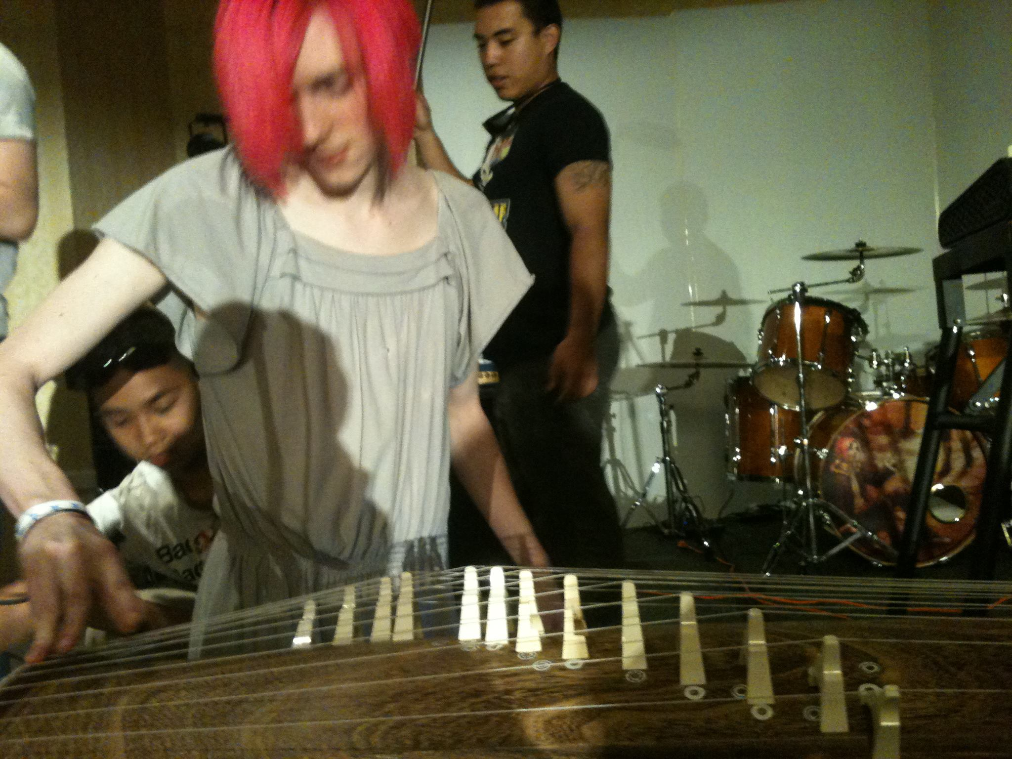 Robbi playing koto during soundcheck while Mike and Suan get ready to film the performance. Photo by Amanda Manzanares