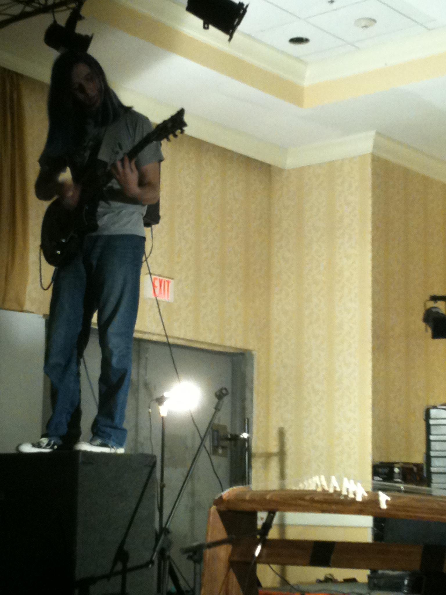 Nat Morkan, nailing the guitar solo in GRAVITY. Photo by Amanda Manzanares