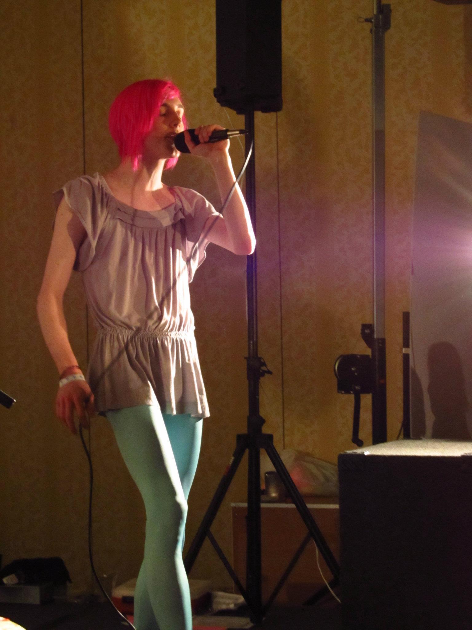 Robbi onstage at Chibi-Pa MOTO. Photo by Dezmaralla Nowell